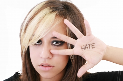 lady showing hate signs